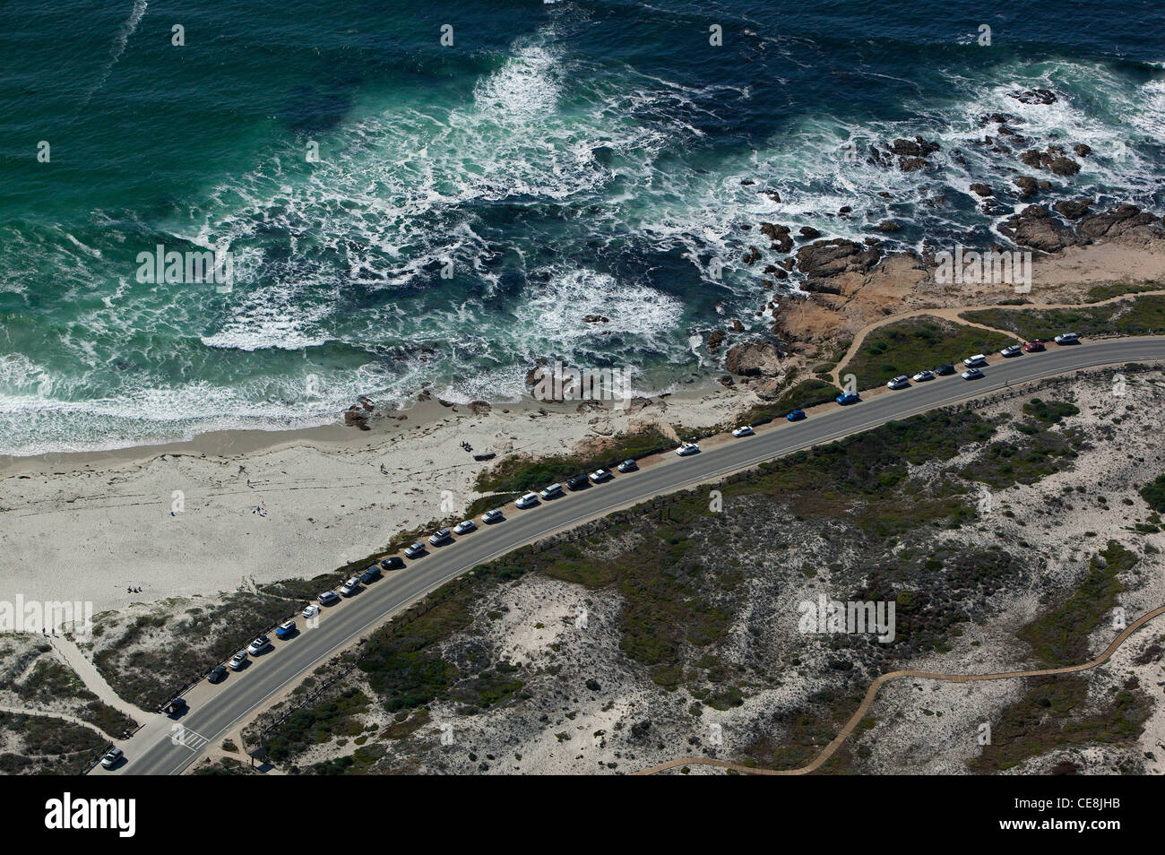 aerial photograph cars parked at popular beach Monterey, California - Stock Image
