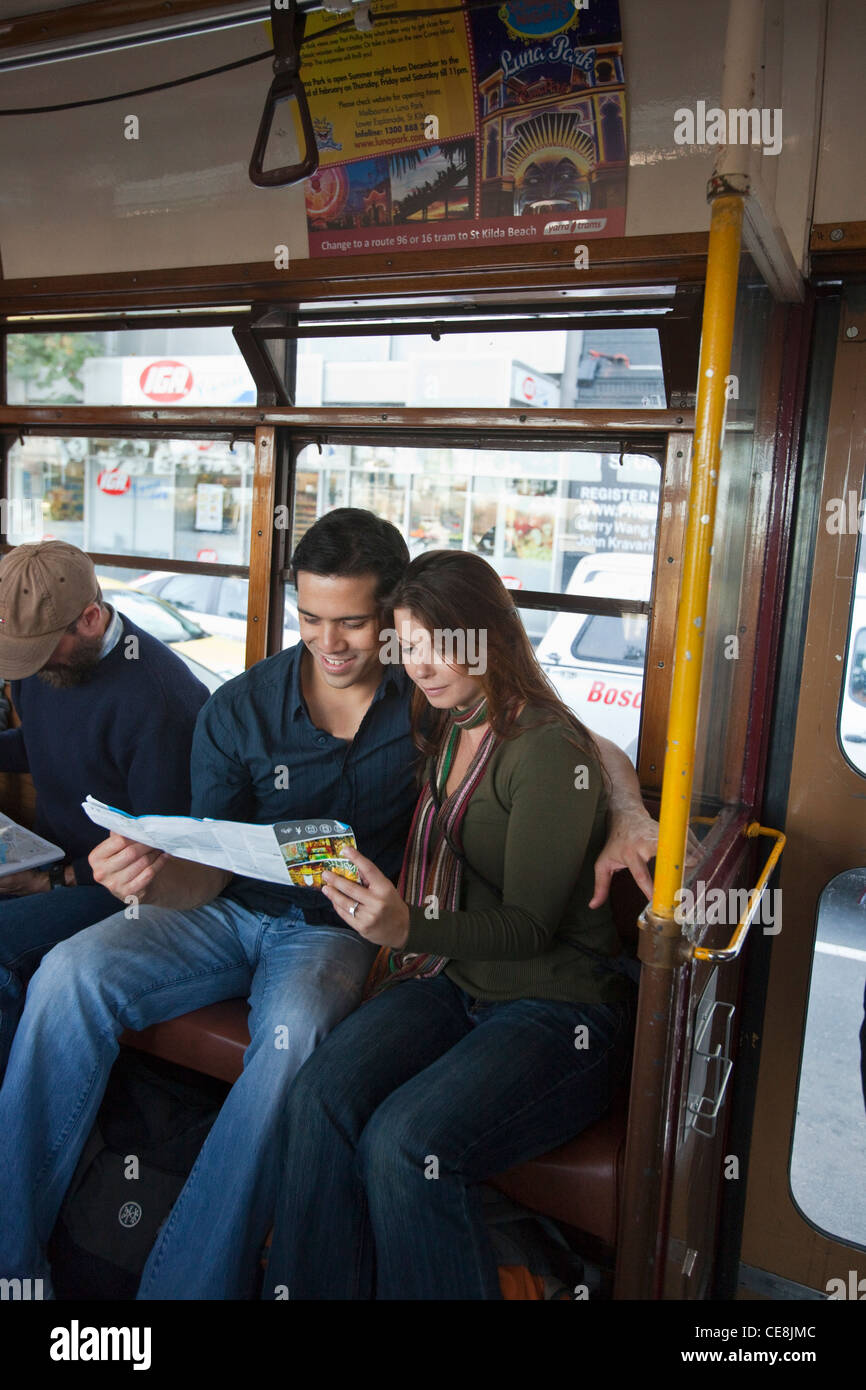 Young Australia Map.Young Couple On City Tram Looking At Tourist Map Melbourne Stock