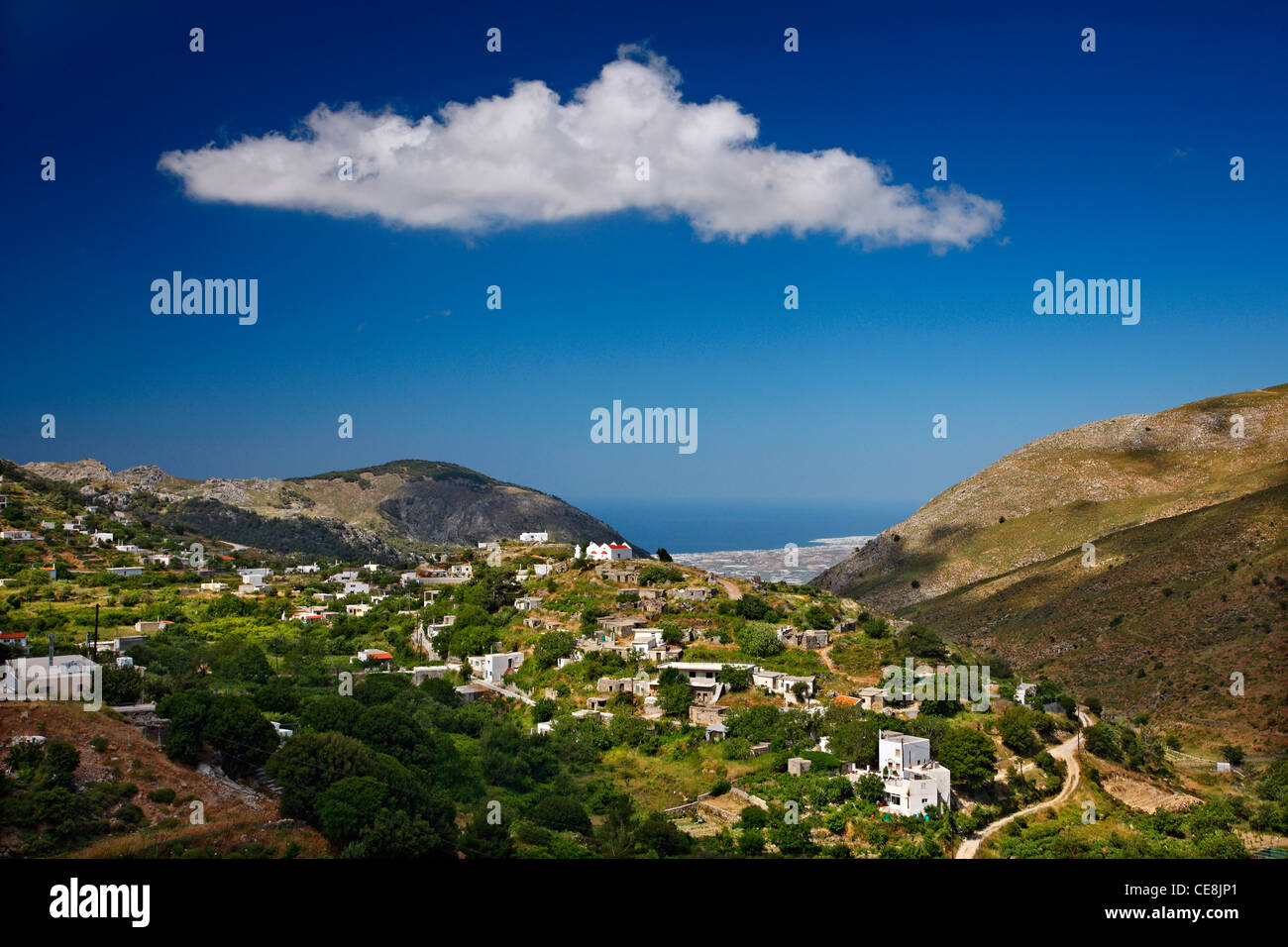 Trypti , a beautiful mountainous village, close to Ierapetra town (which you can see in the BG), Lasithi, Crete, - Stock Image
