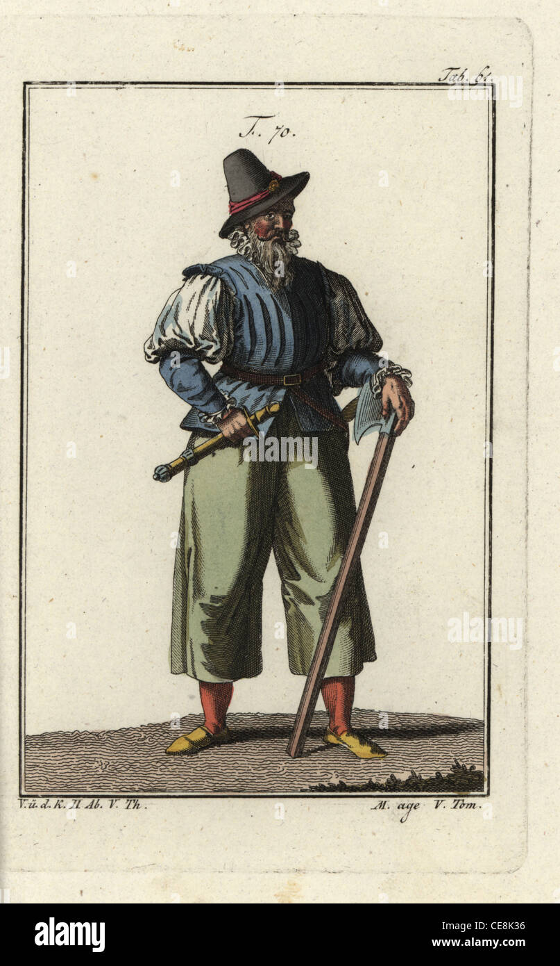 Man of Alsace in the middle ages with sword, dagger and axe. - Stock Image