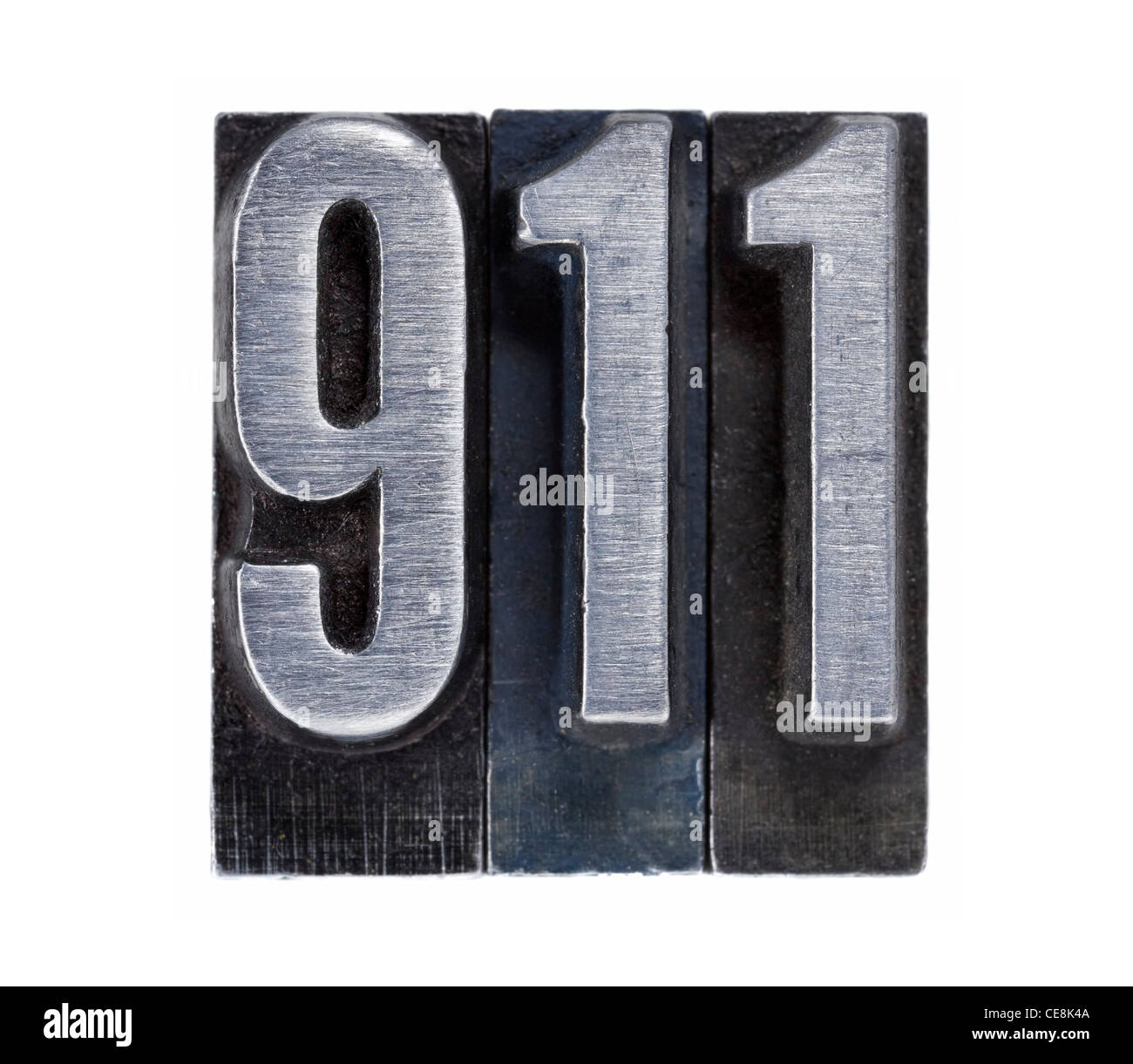 emergency phone number 911 or terrorist attack date - isolated text in vintage grunge metal letterpress type - Stock Image
