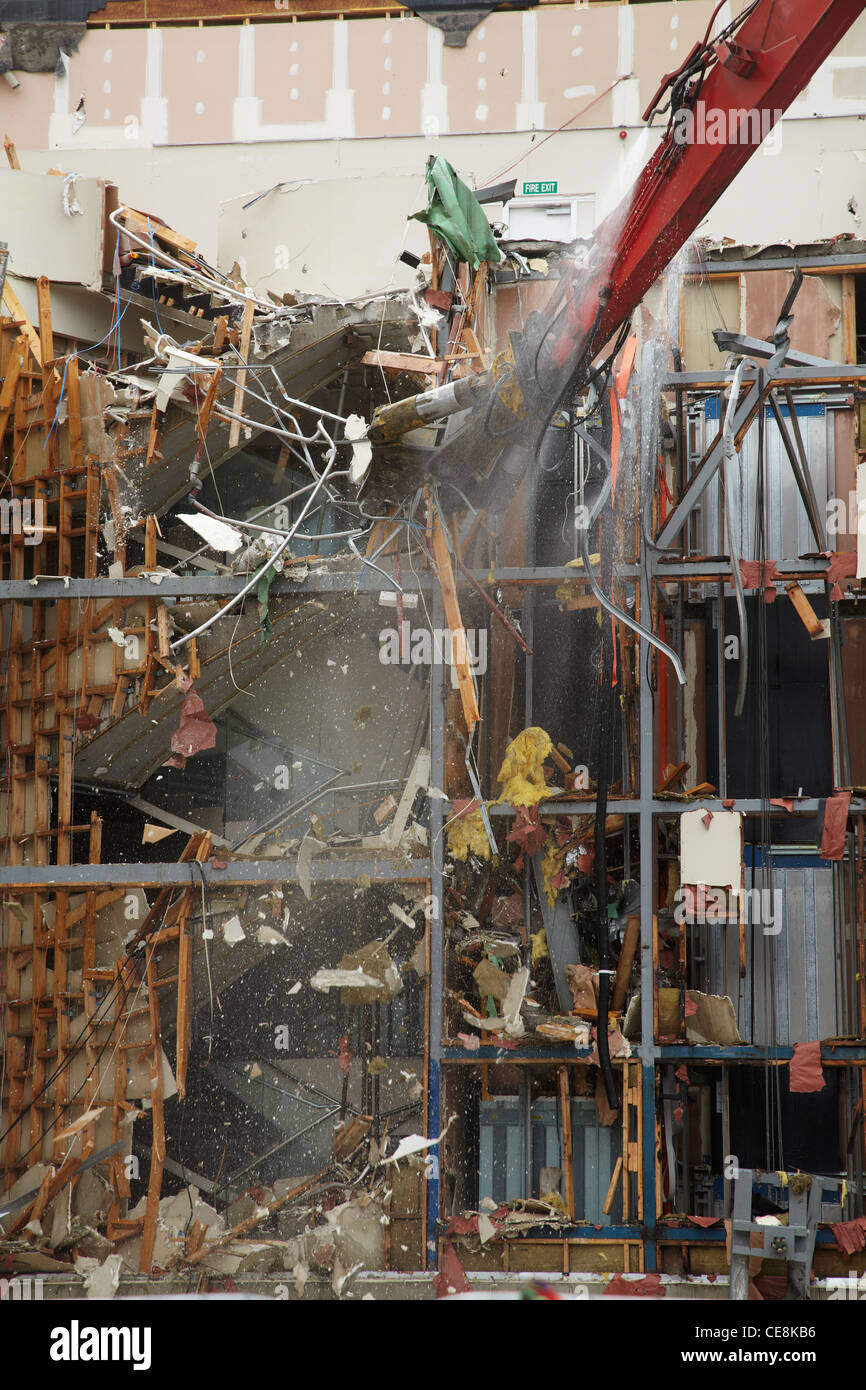 Earthquake-damaged building being demolished, Colombo St, Christchurch, Canterbury, South Island, New Zealand - Stock Image