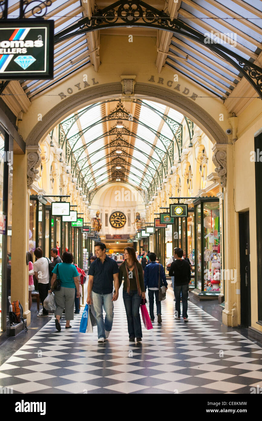 Couple walking with shopping bags in arcade. Melbourne, Victoria, Australia - Stock Image