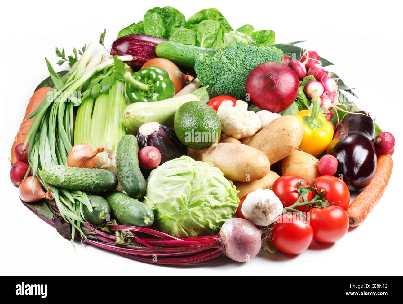 Variety of vegetables are laid out in a circle on a white background. - Stock Image