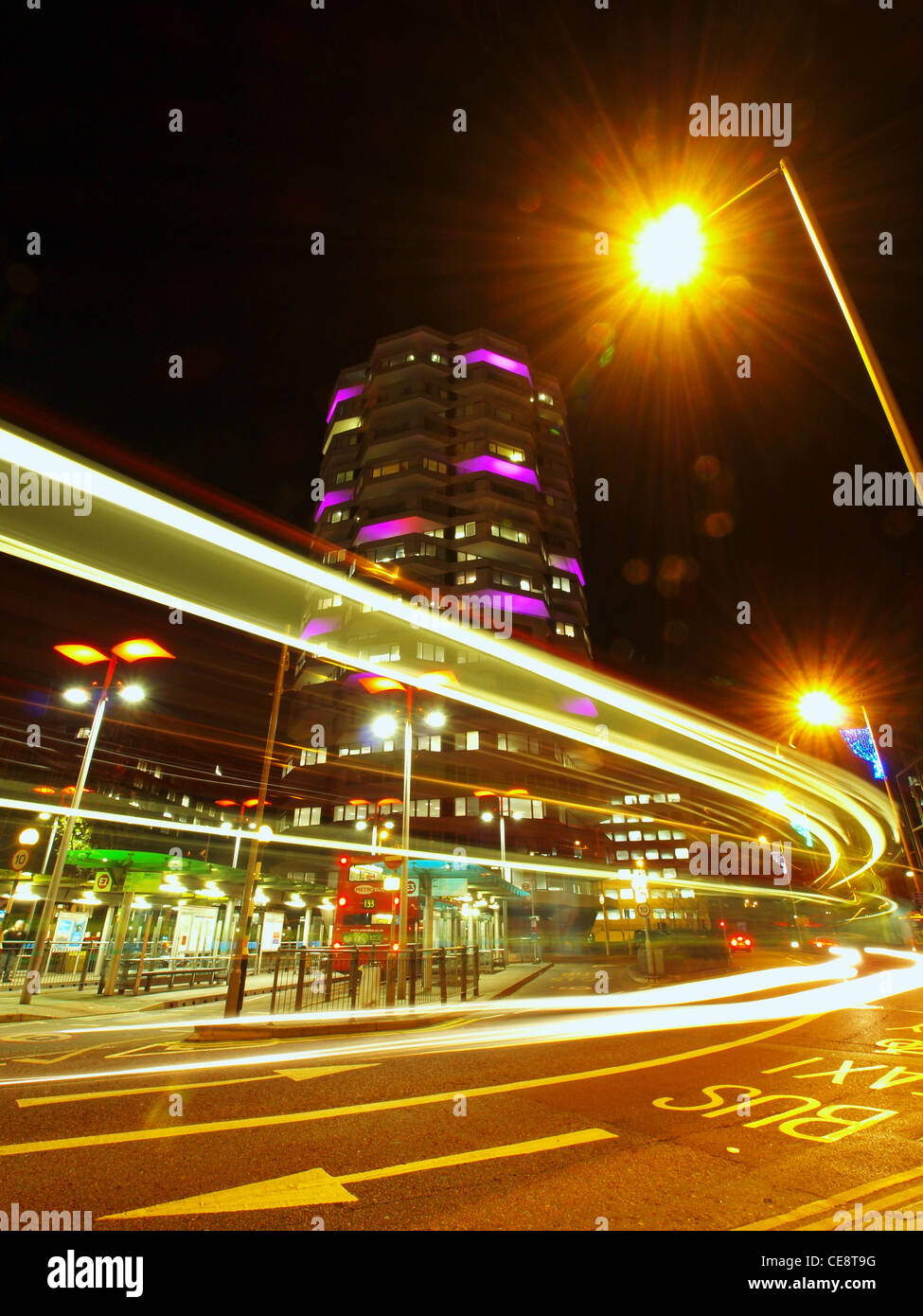 Light trails in front of the illuminated No.1 Croydon towerblock. - Stock Image