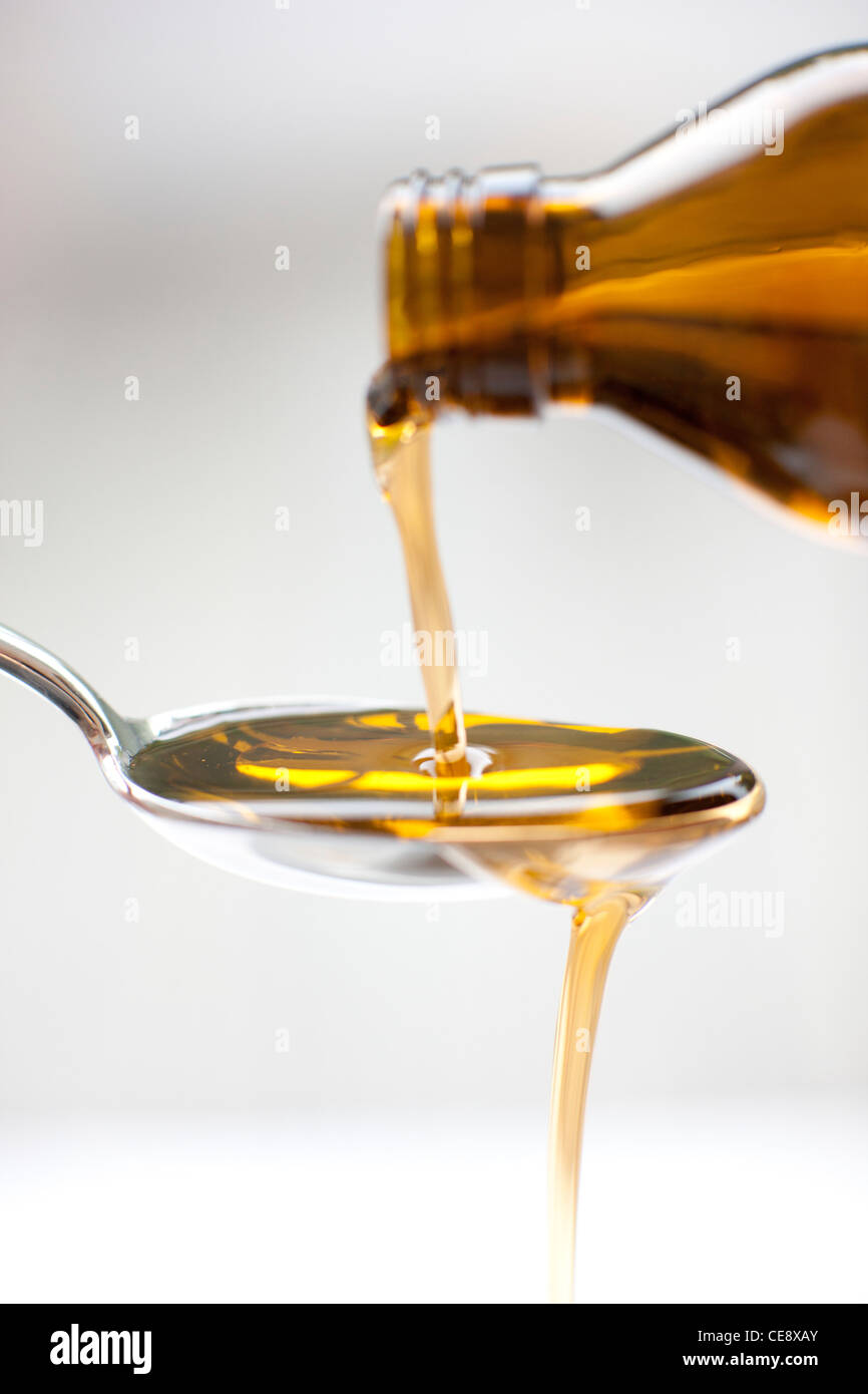 Pouring medicine. - Stock Image