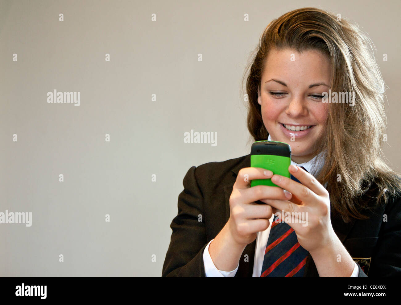 MODEL RELEASED. Teenager texting. - Stock Image