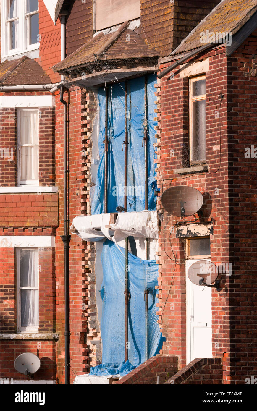 Acrow Props Holding Up The Front Of A Building House Property - Stock Image