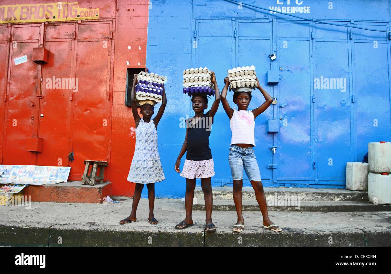Girls sell eggs in central Monrovia, Liberia - Stock Image