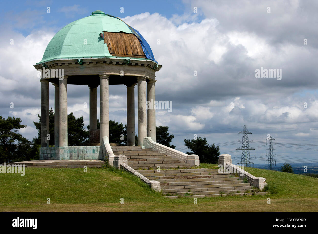 The war memorial in Barr Beacon, Birmingham, after thieves had stolen parts of the copper metal roof. - Stock Image