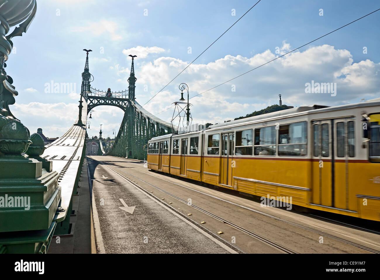 Tram on Liberty Bridge or Freedom Bridge (Szabadsag hid), Budapest, Hungary. Stock Photo