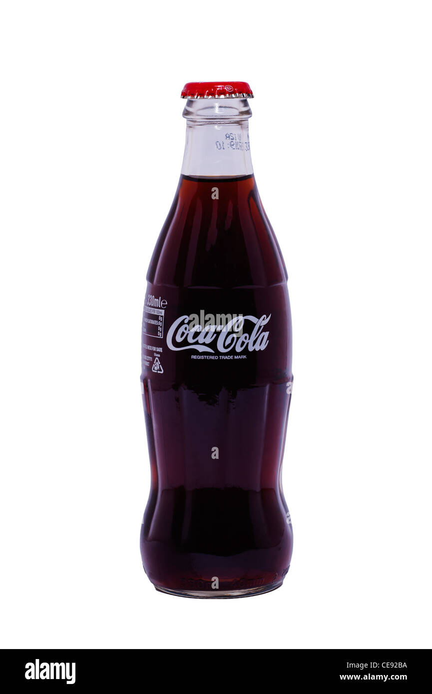A bottle of original Coca Cola ( Coke ) in a glass bottle on a white background - Stock Image