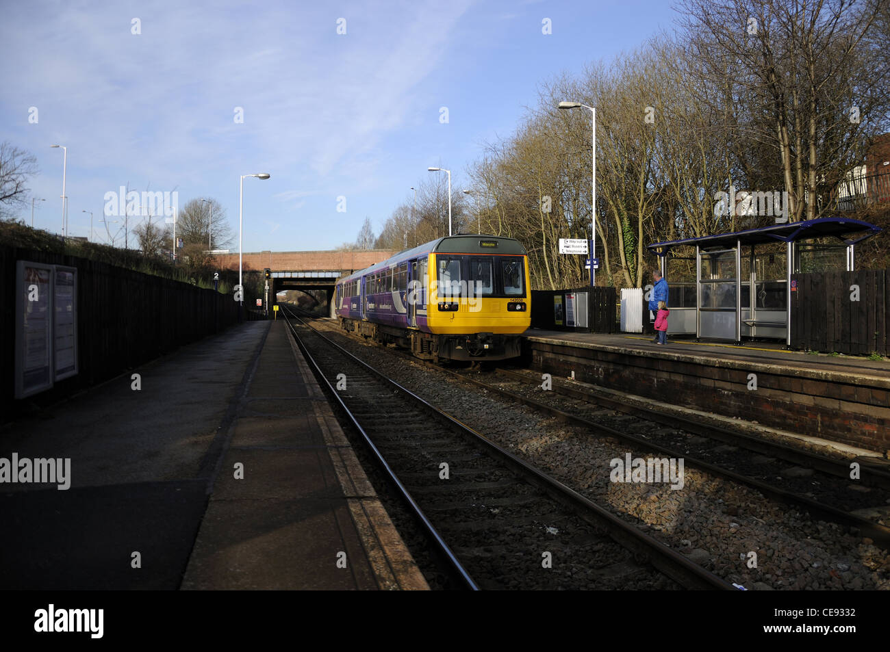 Northern Rail two car passenger train stopping at station for passengers - Stock Image