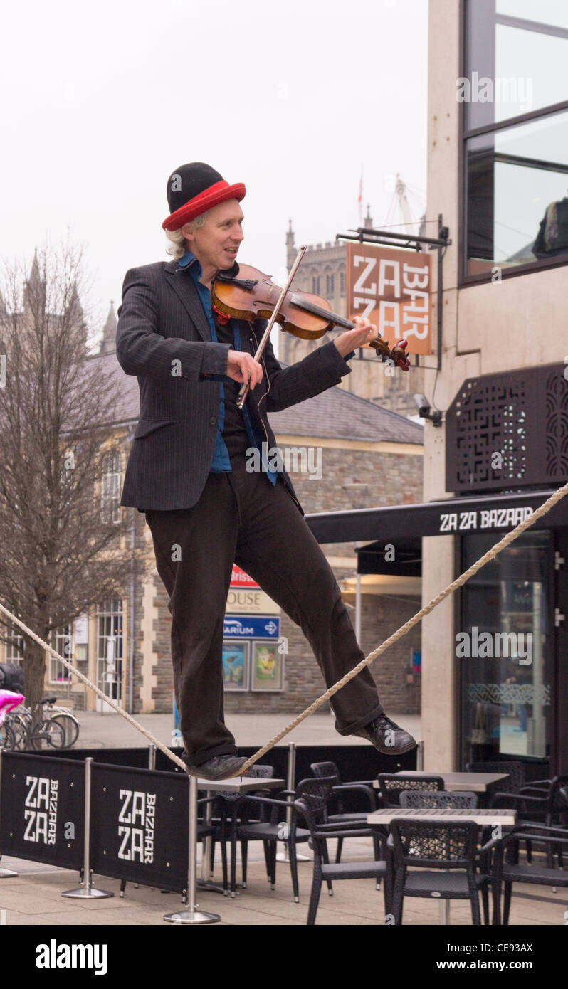 Violin playing slack wire Busker - Stock Image