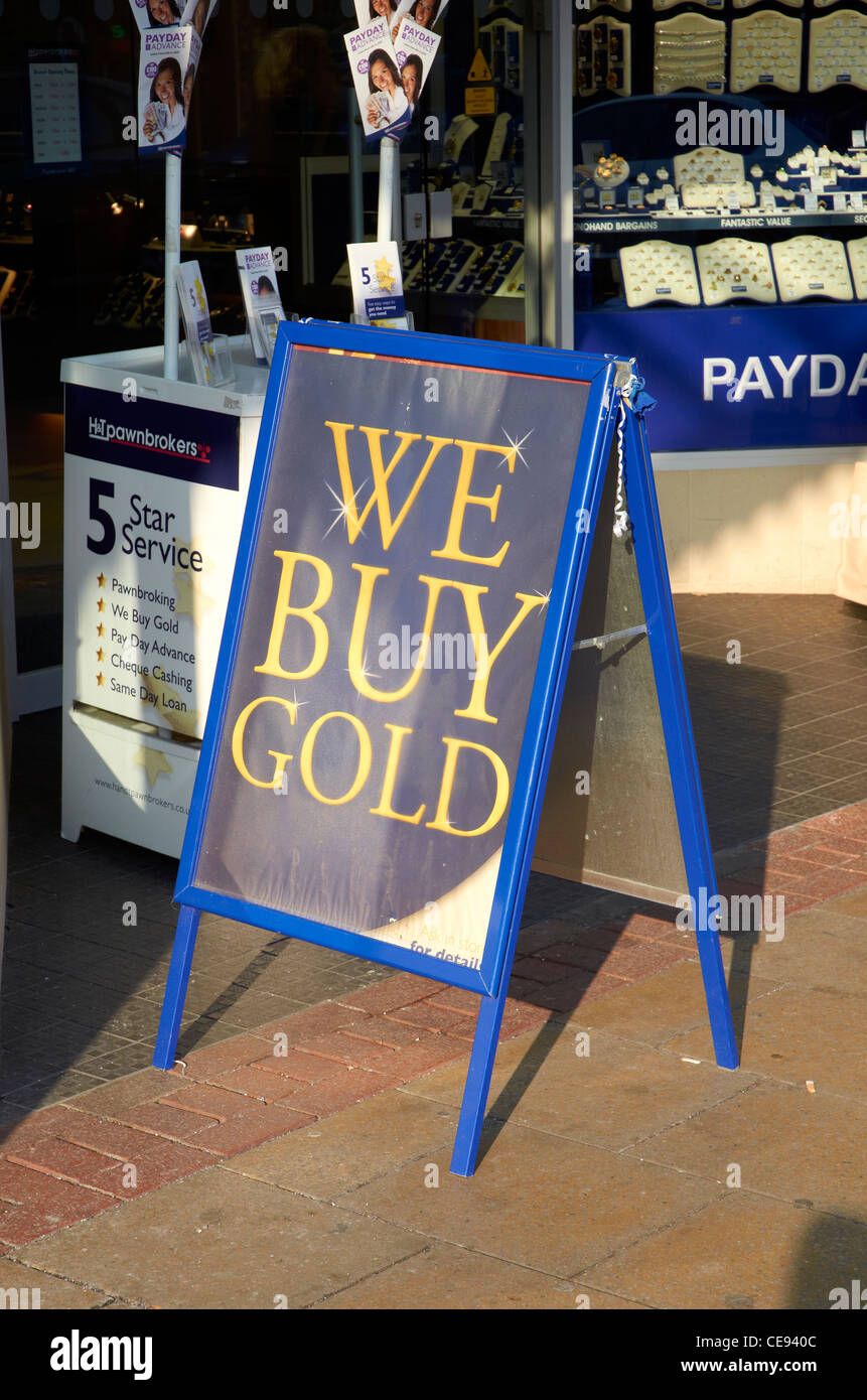 We buy gold sign outside a pawnbrokers shop - Stock Image