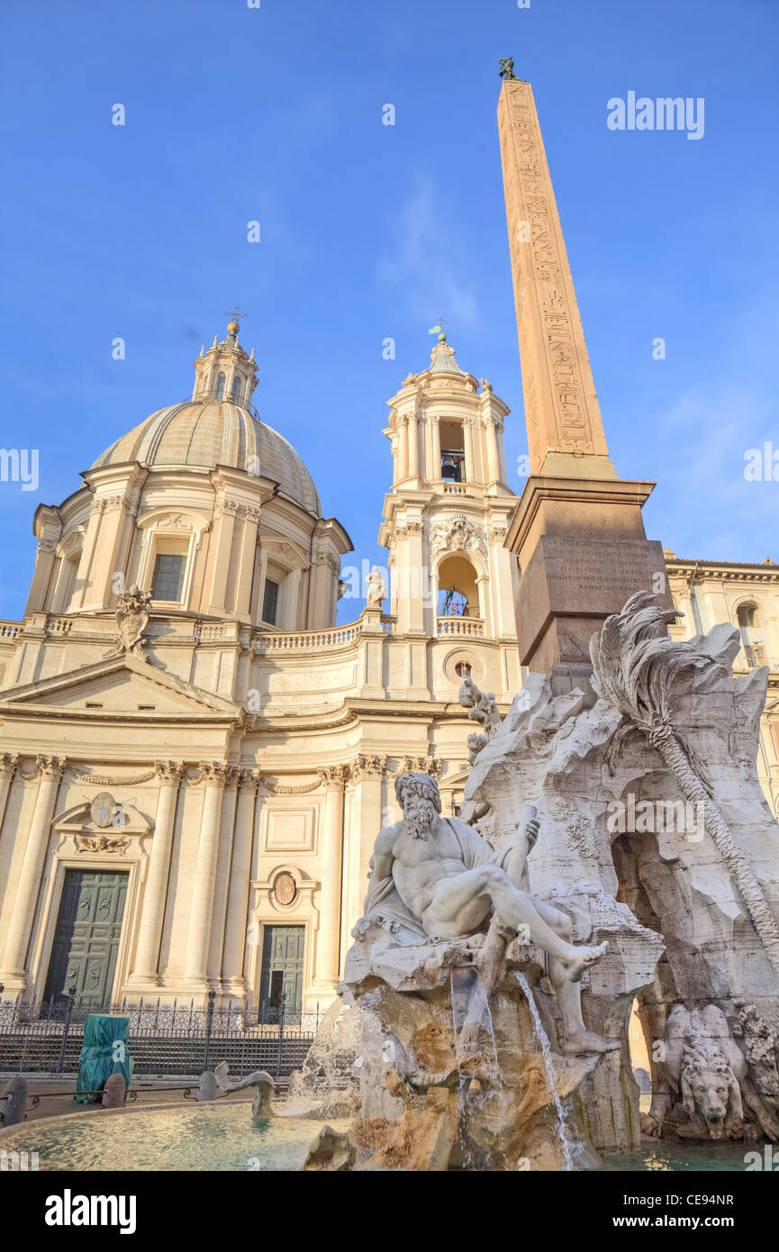 The Four Rivers Fountain - Fountain of the Four Rivers - on the Piazza Navona in Rome, Lazio, Italy. - Stock Image