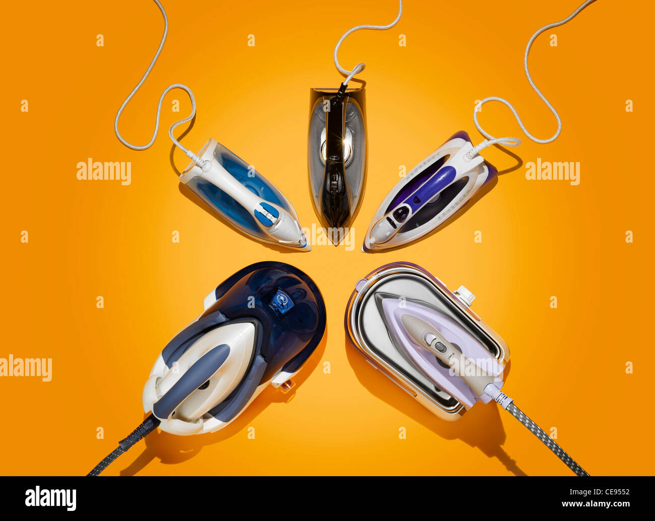 Five irons on a yellow background Stock Photo