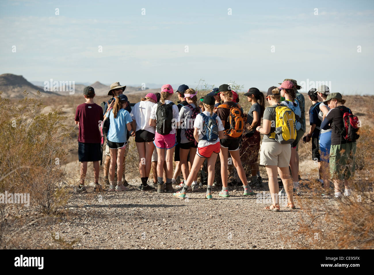 Group of middle school students on class trip to Big Bend National Park in Texas gather around tour guide in the - Stock Image