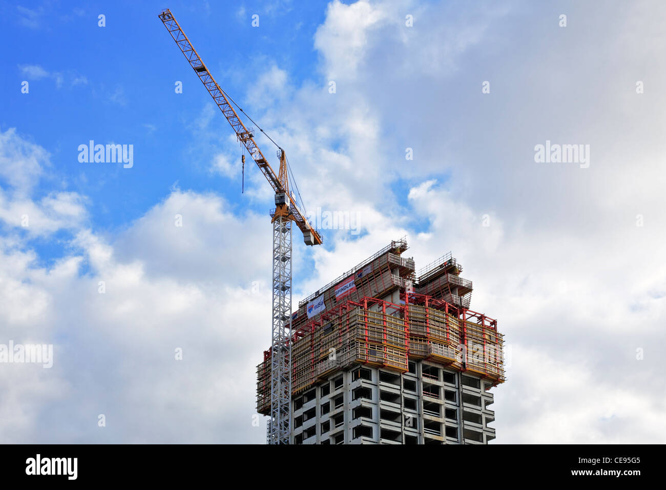 High-rise building, construction site with a crane, Kop van Zuid, Rotterdam, Holland, Netherlands, Europe - Stock Image