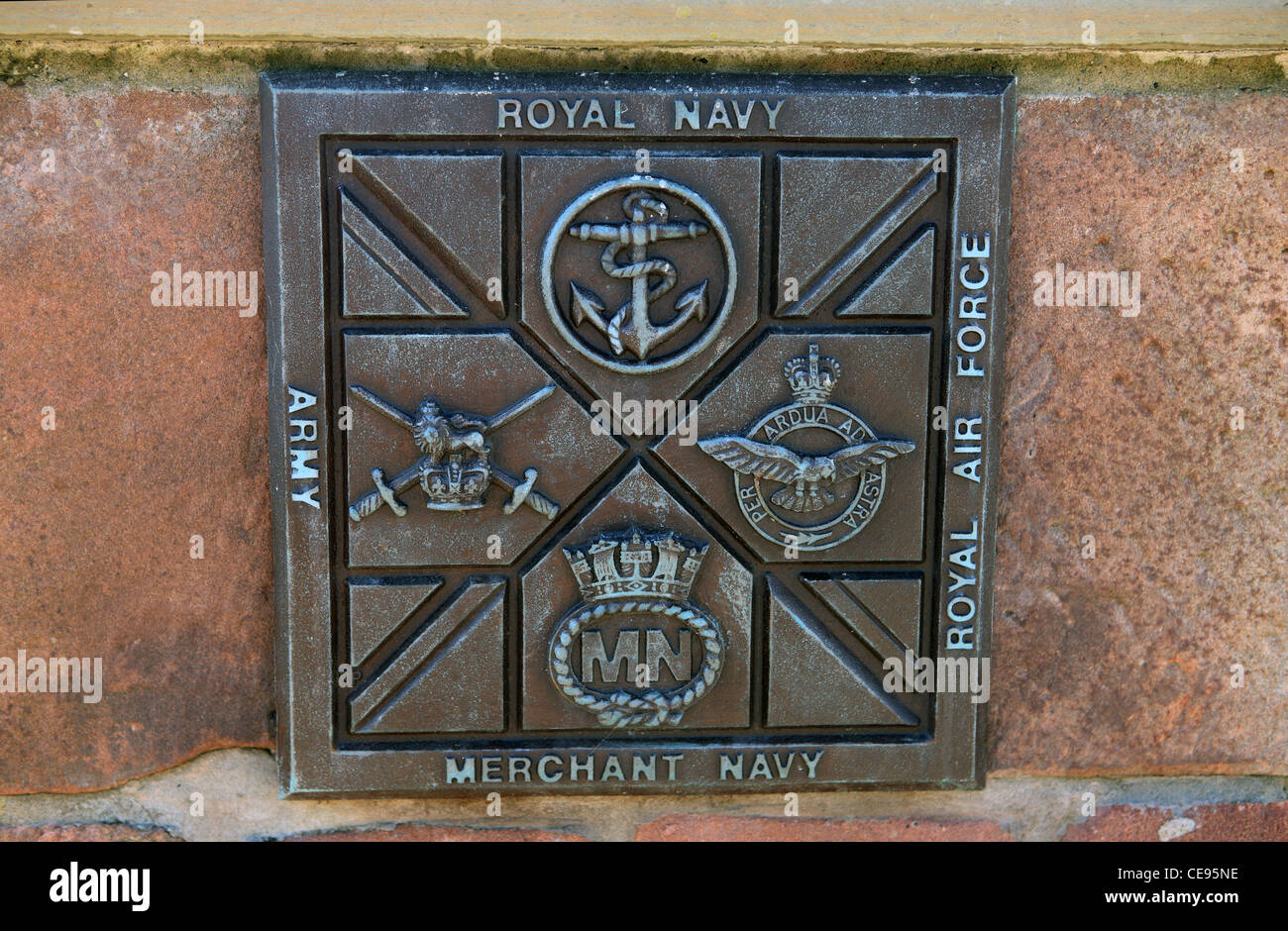 Plaque depicting the UK forces, Army, Royal Navy, Royal Air Force and the Merchant Navy - Stock Image