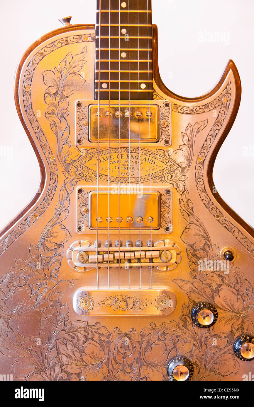 An engraved electric guitar. The engraving is like that done on a shotgun. - Stock Image