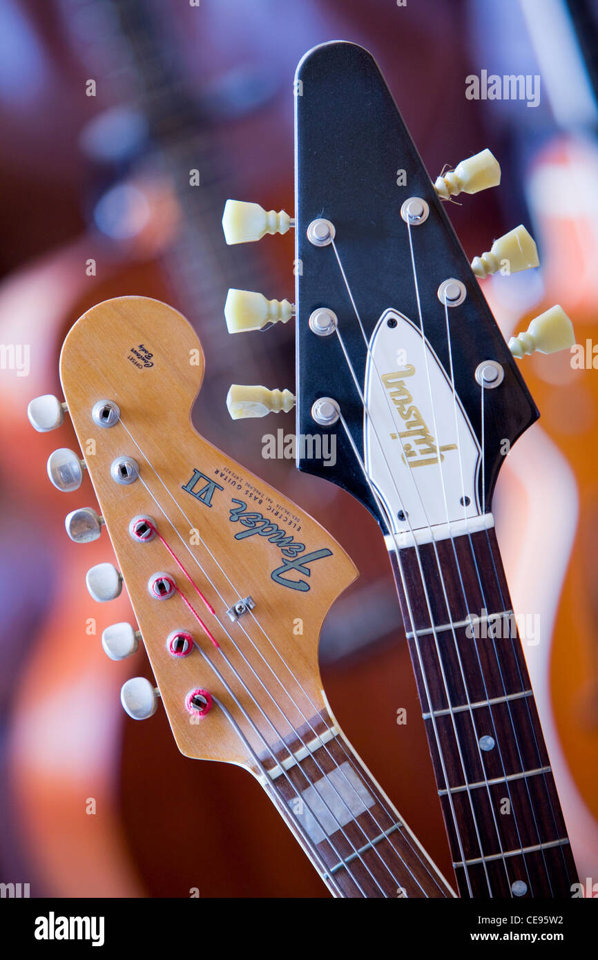 The neck of a Fender Bass 6 guitar owned by Noel Redding and used by Jimi Hendrix and a Gibson Flying V owned by - Stock Image