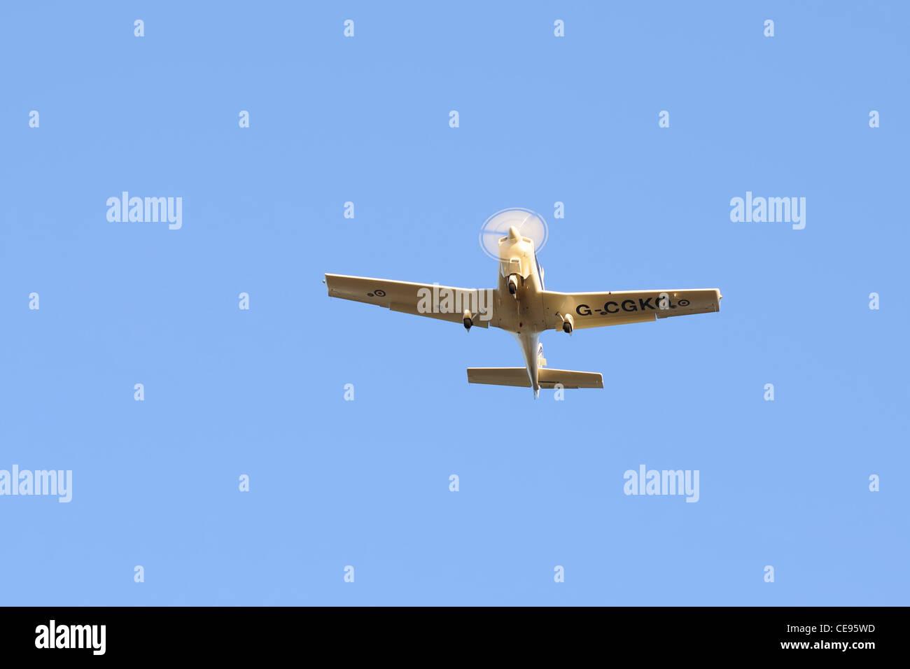 A Royal air force, VT Aerospace Grob G115 Tutor / Heron G-CGKO taken over Glasgow airport, Scotland, UK - Stock Image