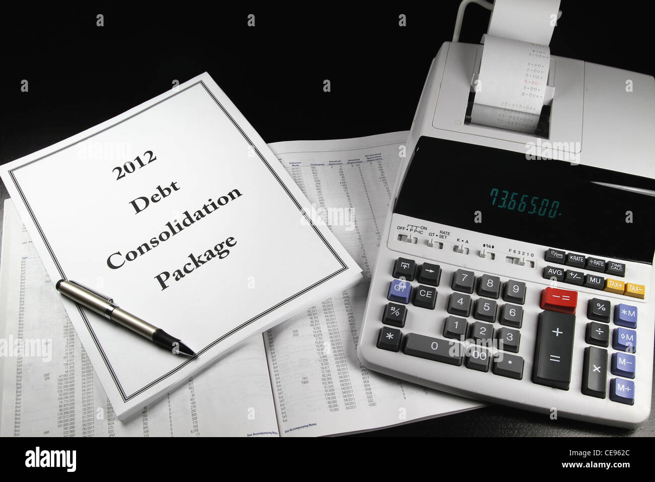 A 2012 debt consolidation package on top of a prospectus with a pen. - Stock Image