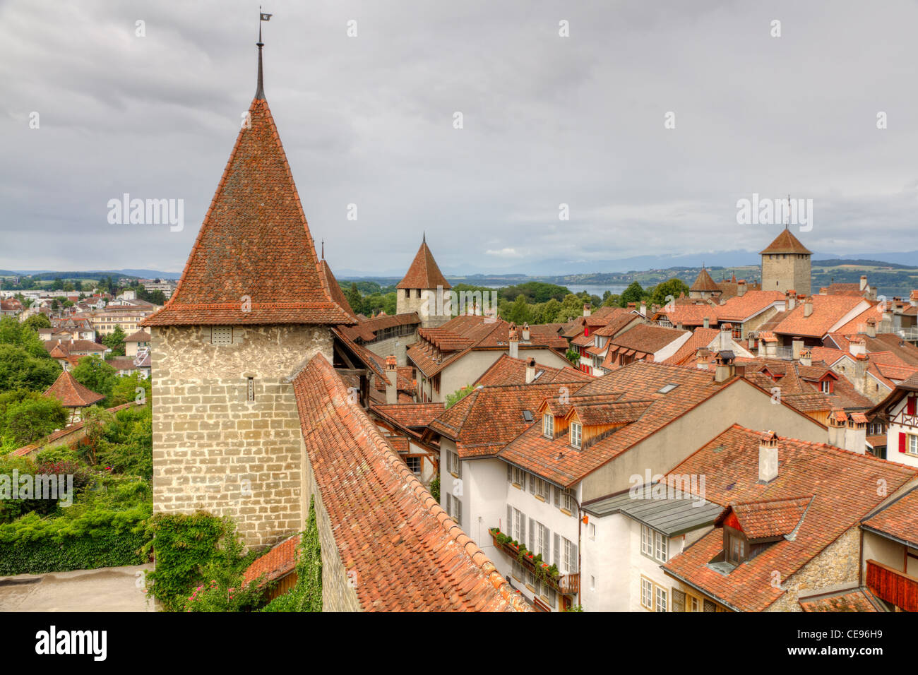 Murten old town with narrow lanes city wall, watch tower and clay shingle roofs, Switzerland - Stock Image