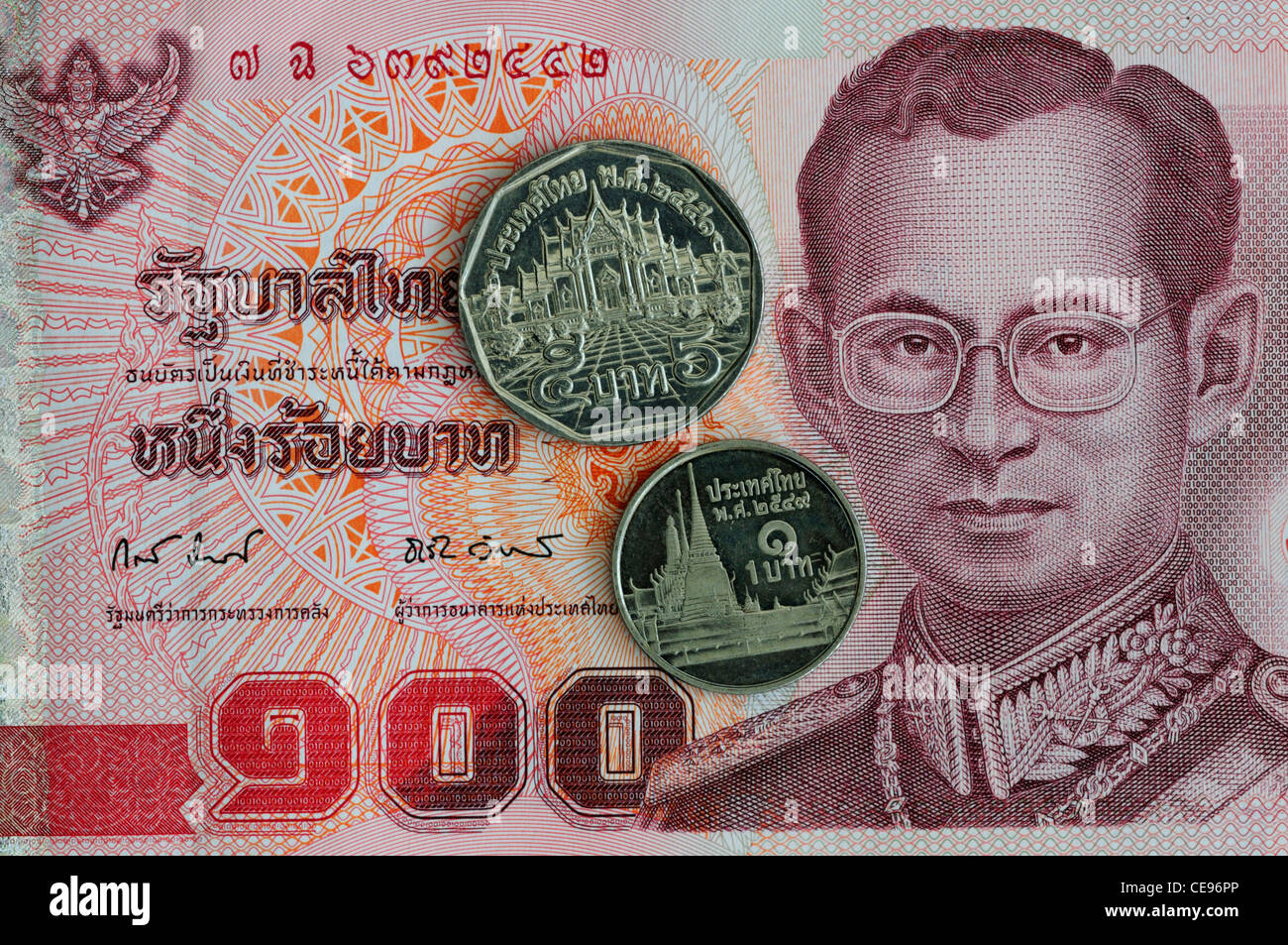 One Hundred Thai Baht Banknote with 5 Baht and 1 Baht Coins - Stock Image