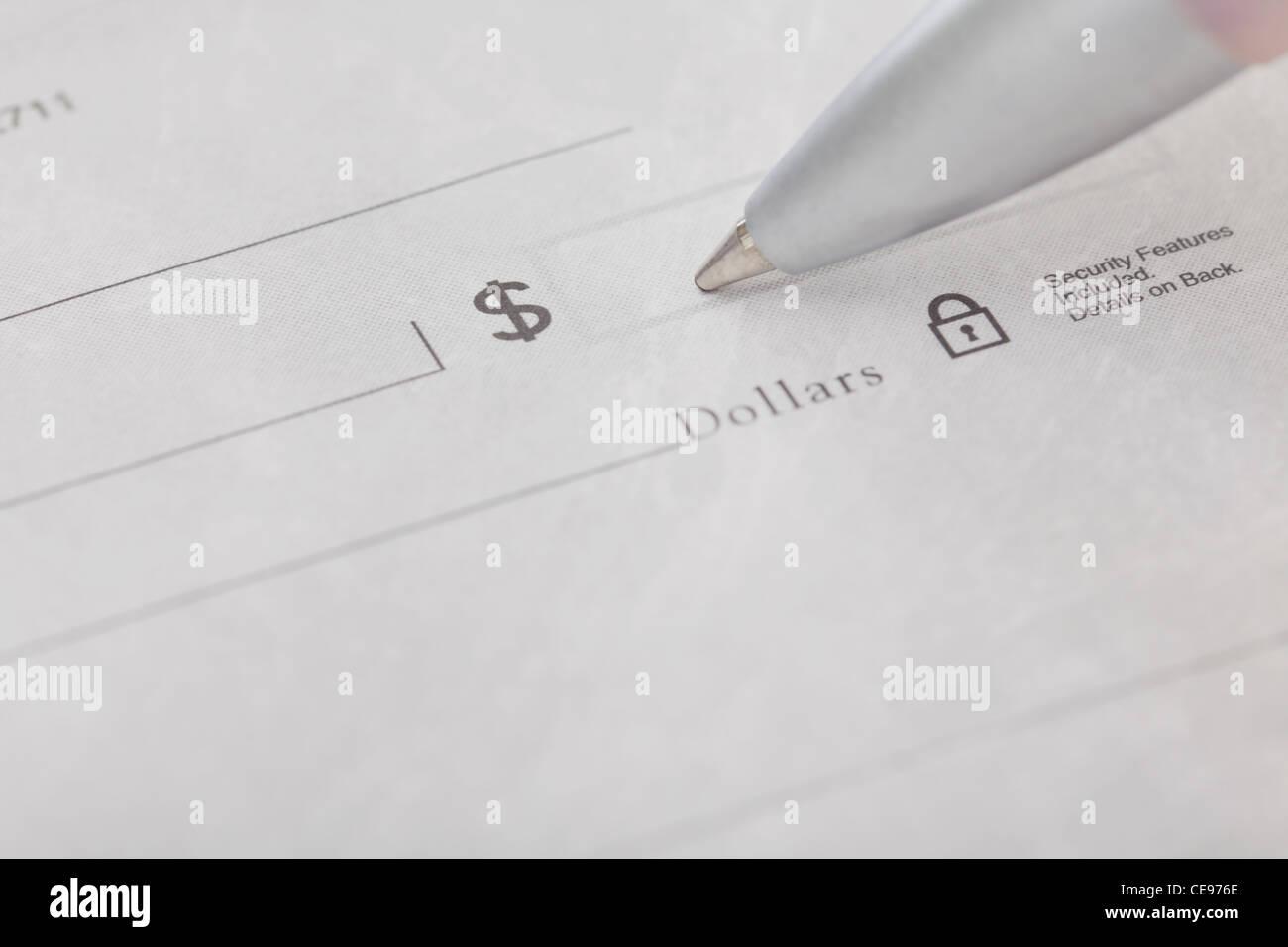 Studio shot of pen writing on receipt - Stock Image