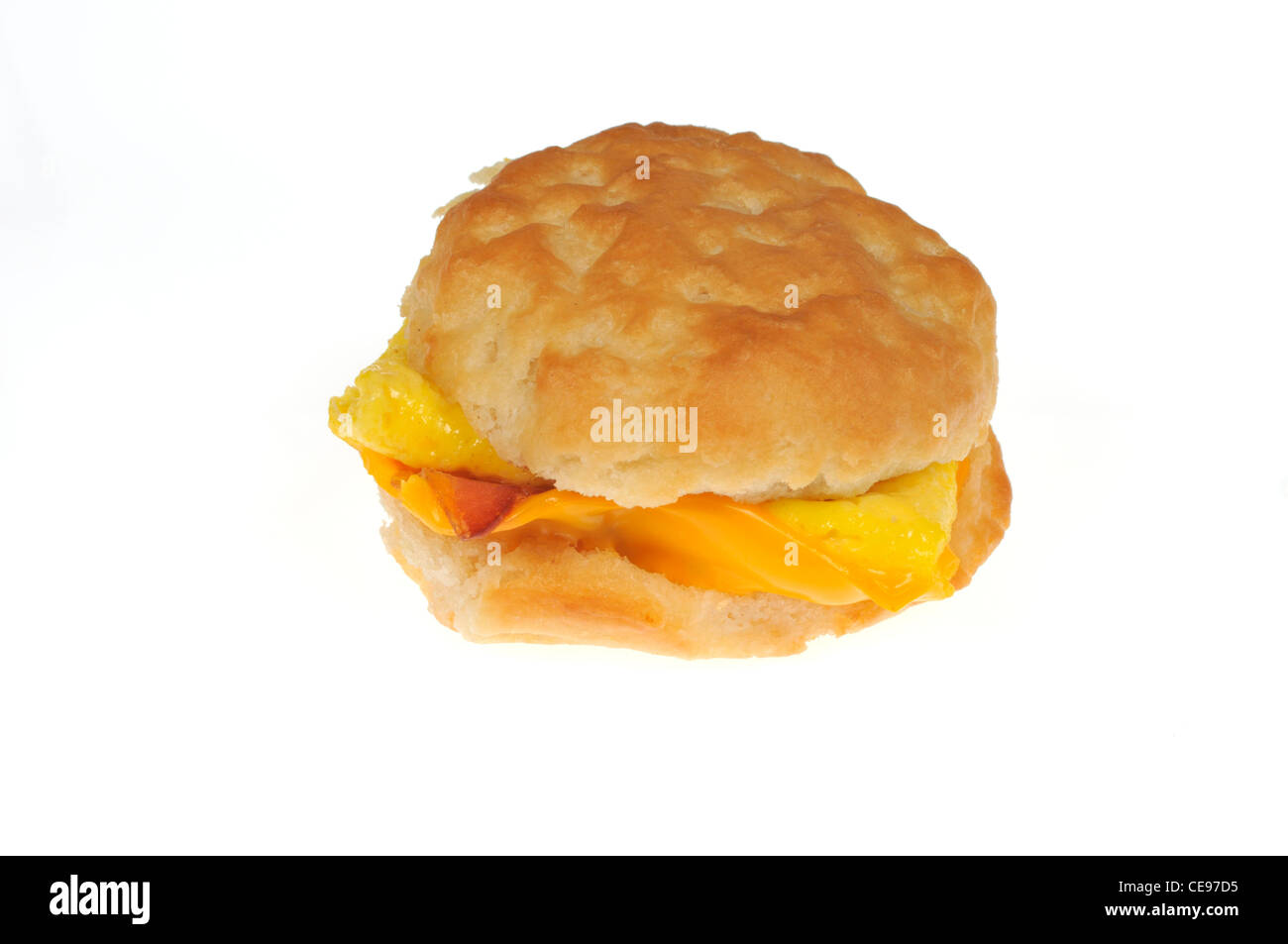 McDoanlds bacon egg and cheese biscuit sandwich on white background cut out. - Stock Image