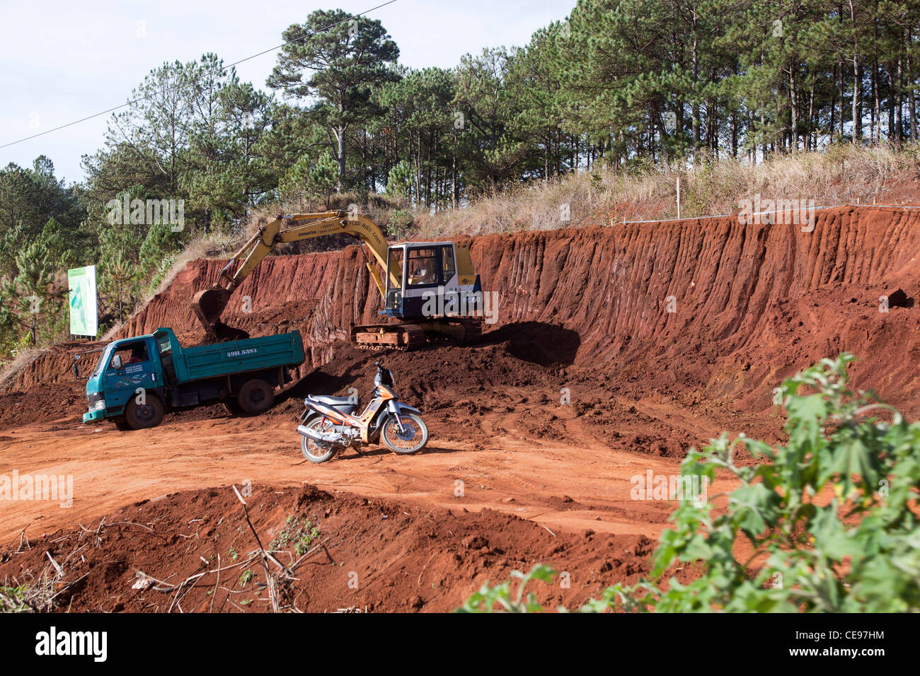 Contractors excavating Landscape on building site near Dalat - Stock Image