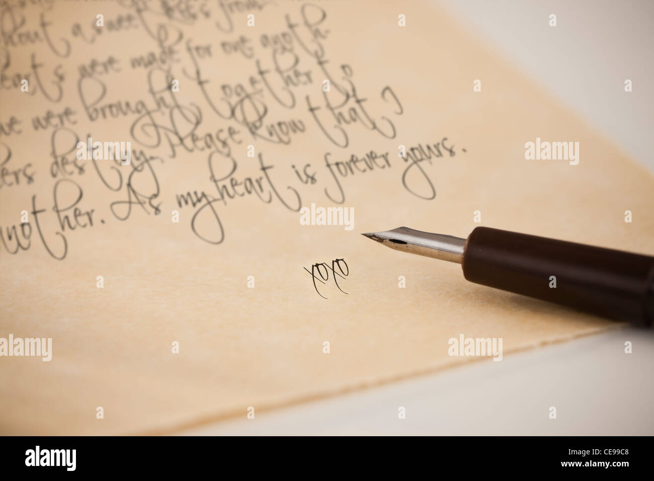 Close-up of love letter and fountain pen - Stock Image