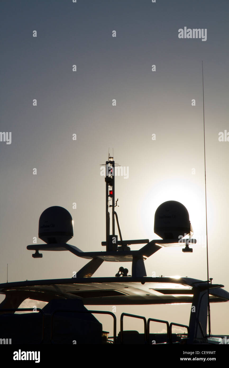 radar and safety equipment equipments for navigation silhouettes mounted aboard on luxury yacht motorboat - Stock Image
