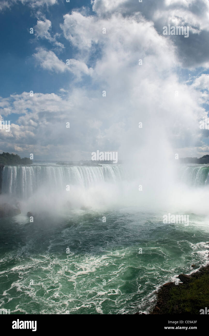 Horseshoe Falls on the Canadian side of Niagara falls, showing mist and spray. - Stock Image