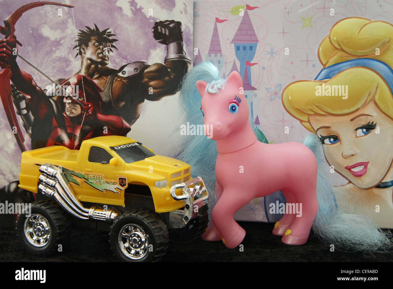 Toys representing extremes of stereotypical masculinity and femininity. - Stock Image