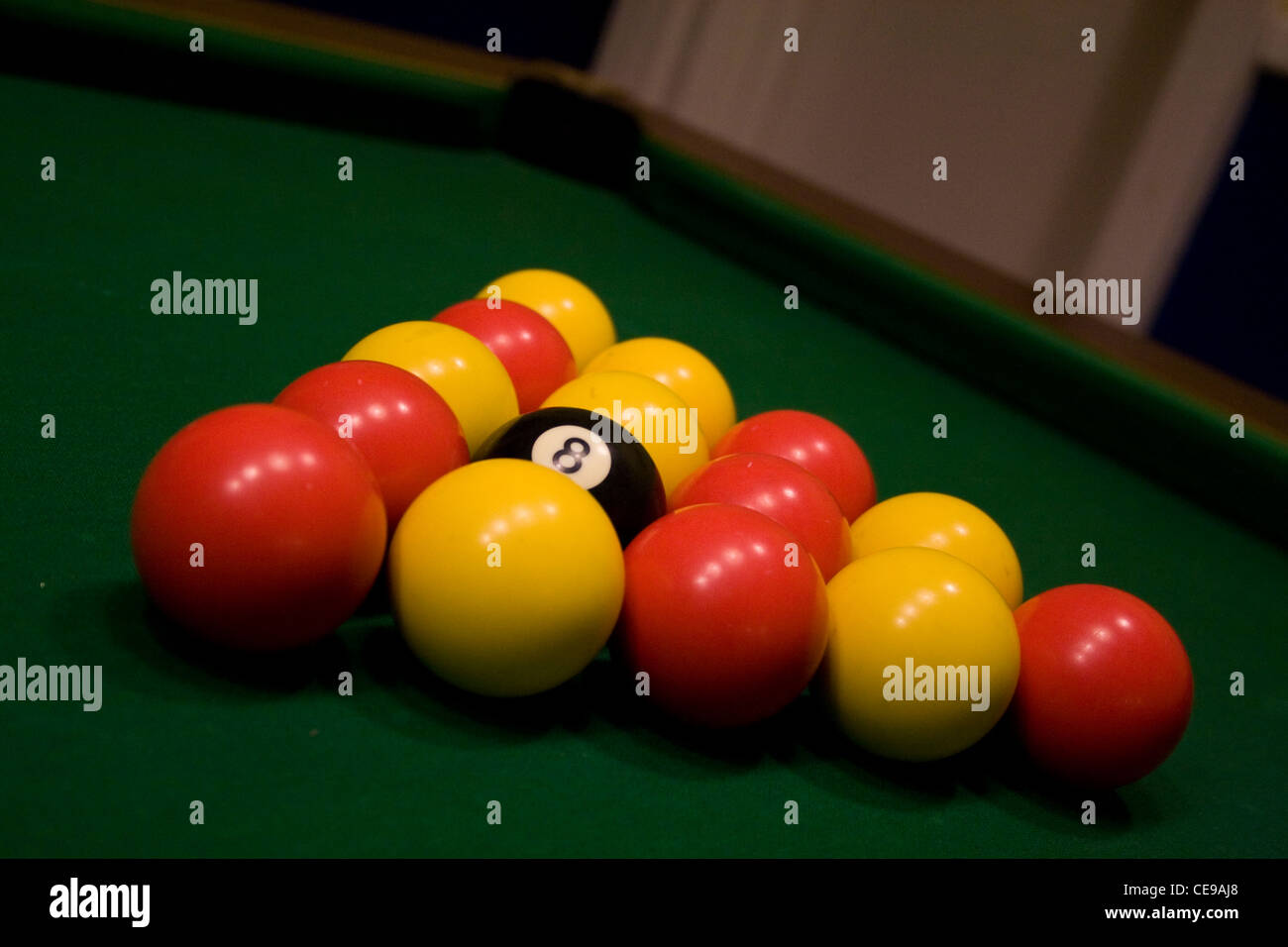 8 Ball Pool Balls racked up on the table ready for a game. - Stock Image