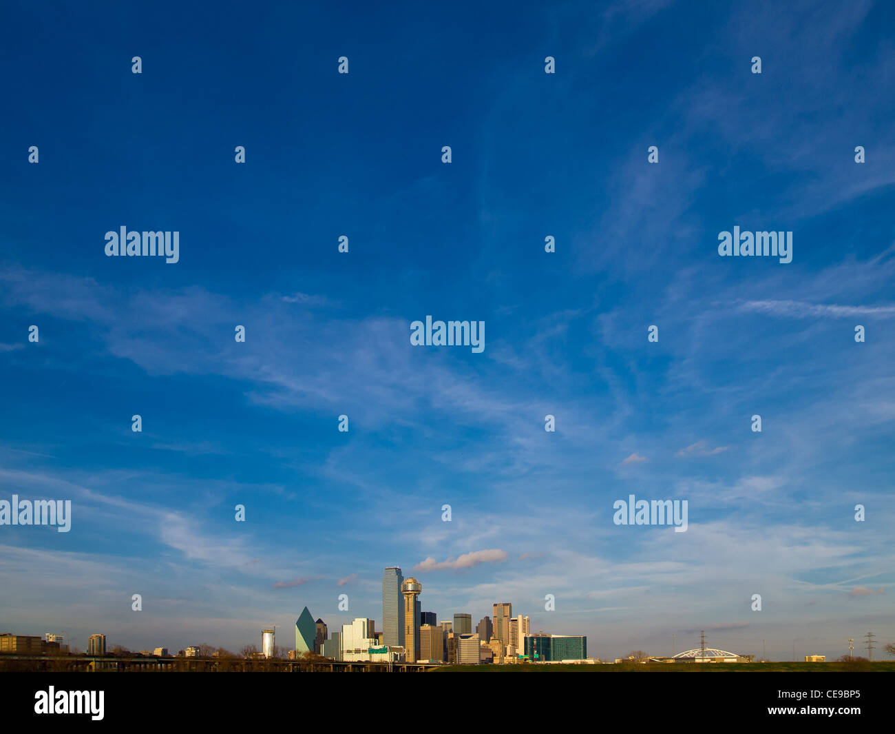 The Dallas, Texas skyline with beautiful blue sky and clouds. - Stock Image