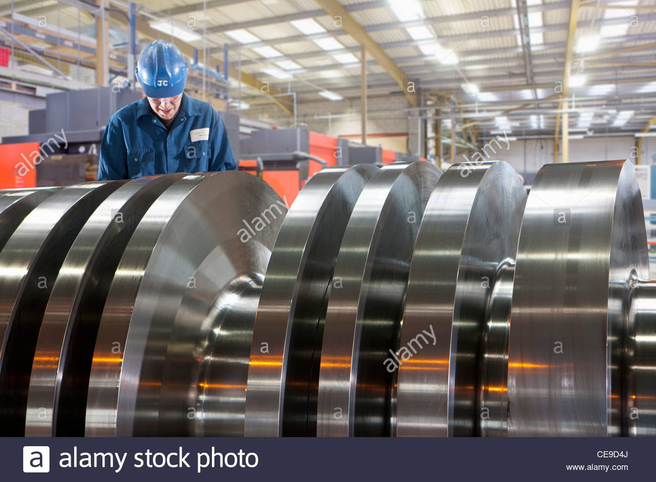 Engineer working on metal machinery Stock Photo