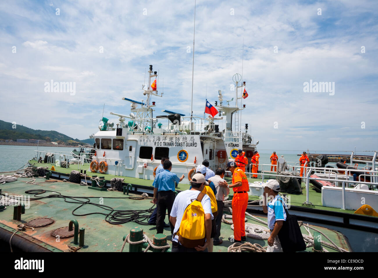 Taiwanese cost guard members welcome aboard a group of Taiwanese dignitaries onto a cutter boat August 15 at Matzu Stock Photo
