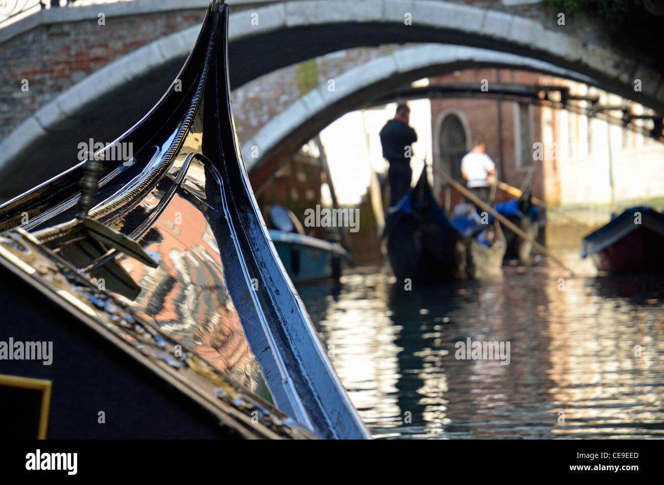 Gondola bow and gondoliers on the canals, Venice, Italy - Stock Image