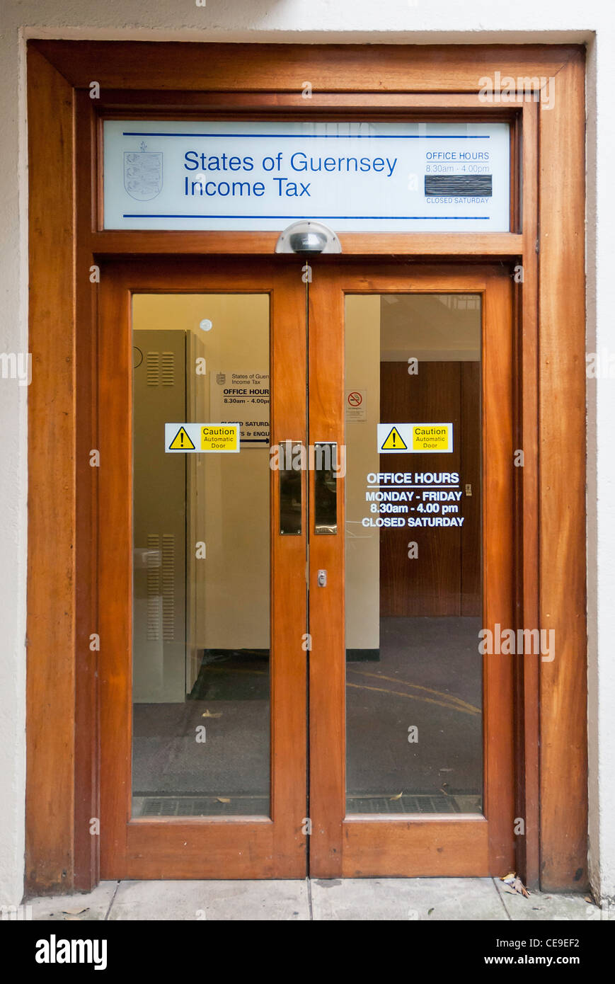 Entrance doorway for the States of Guernsey Income Tax offices. - Stock Image