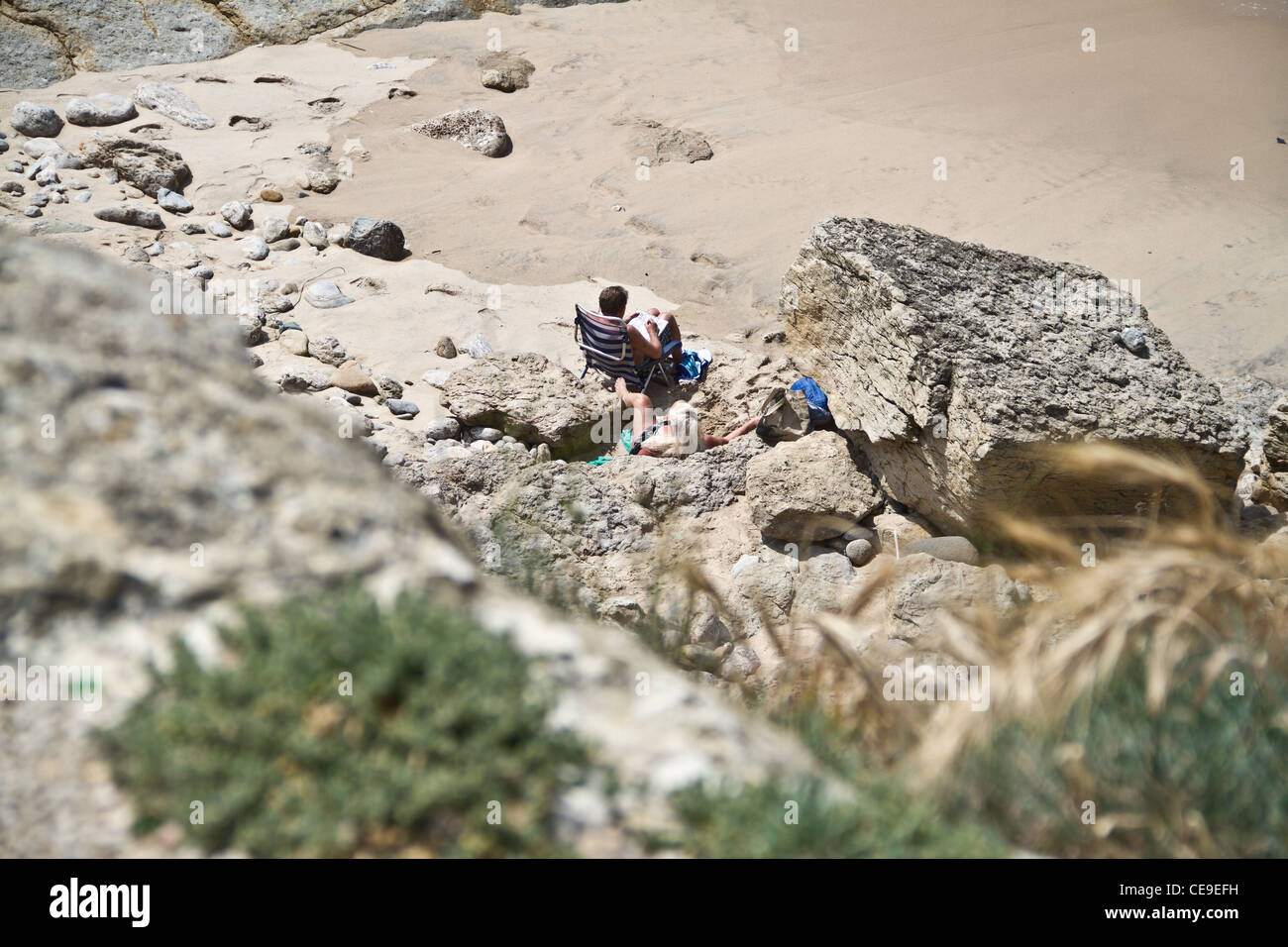 Two foreigners sunbathing in Guincho, Greater Lisbon, Portugal - Stock Image