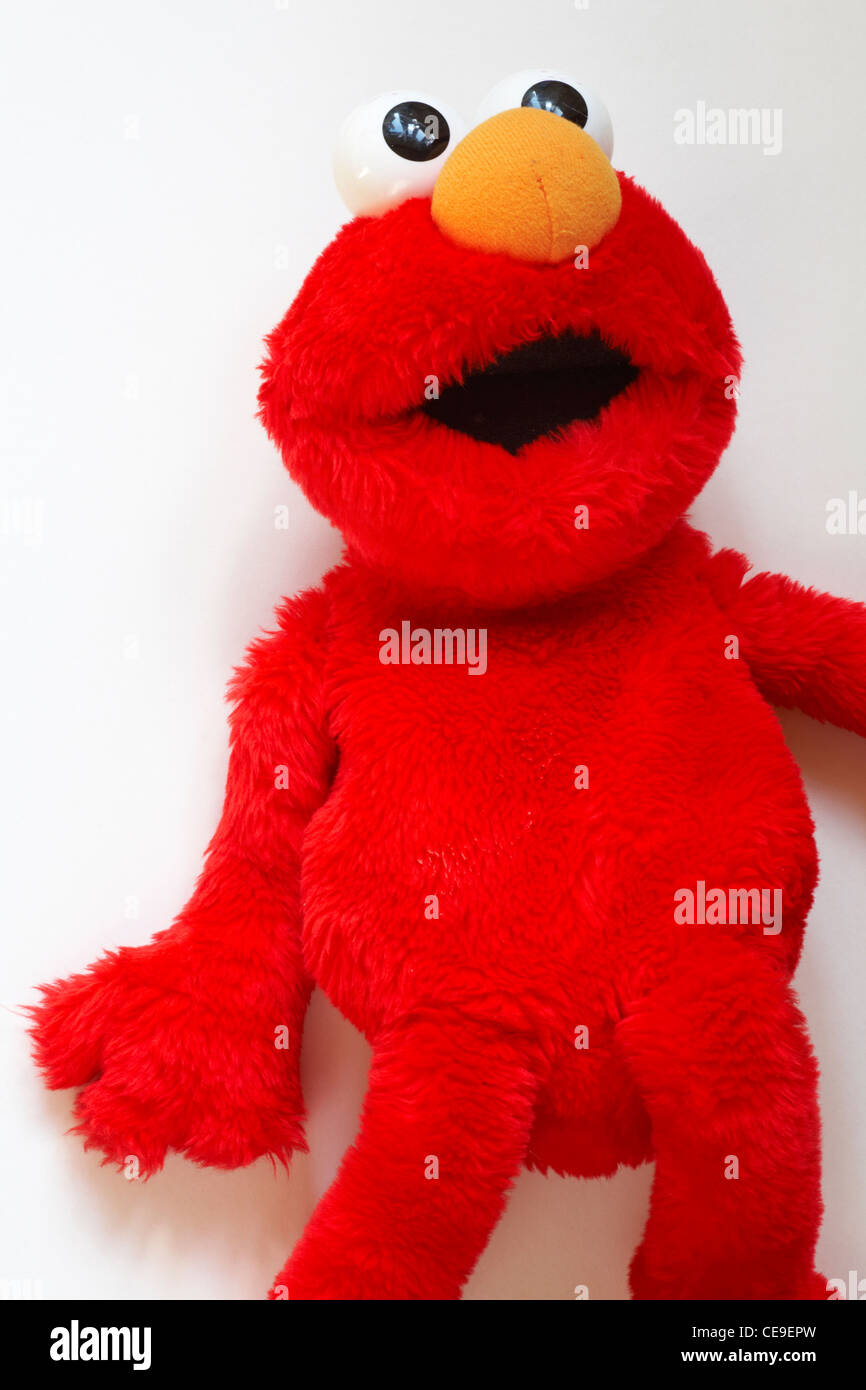 Elmo the muppet figure from Sesame Street red soft cuddly