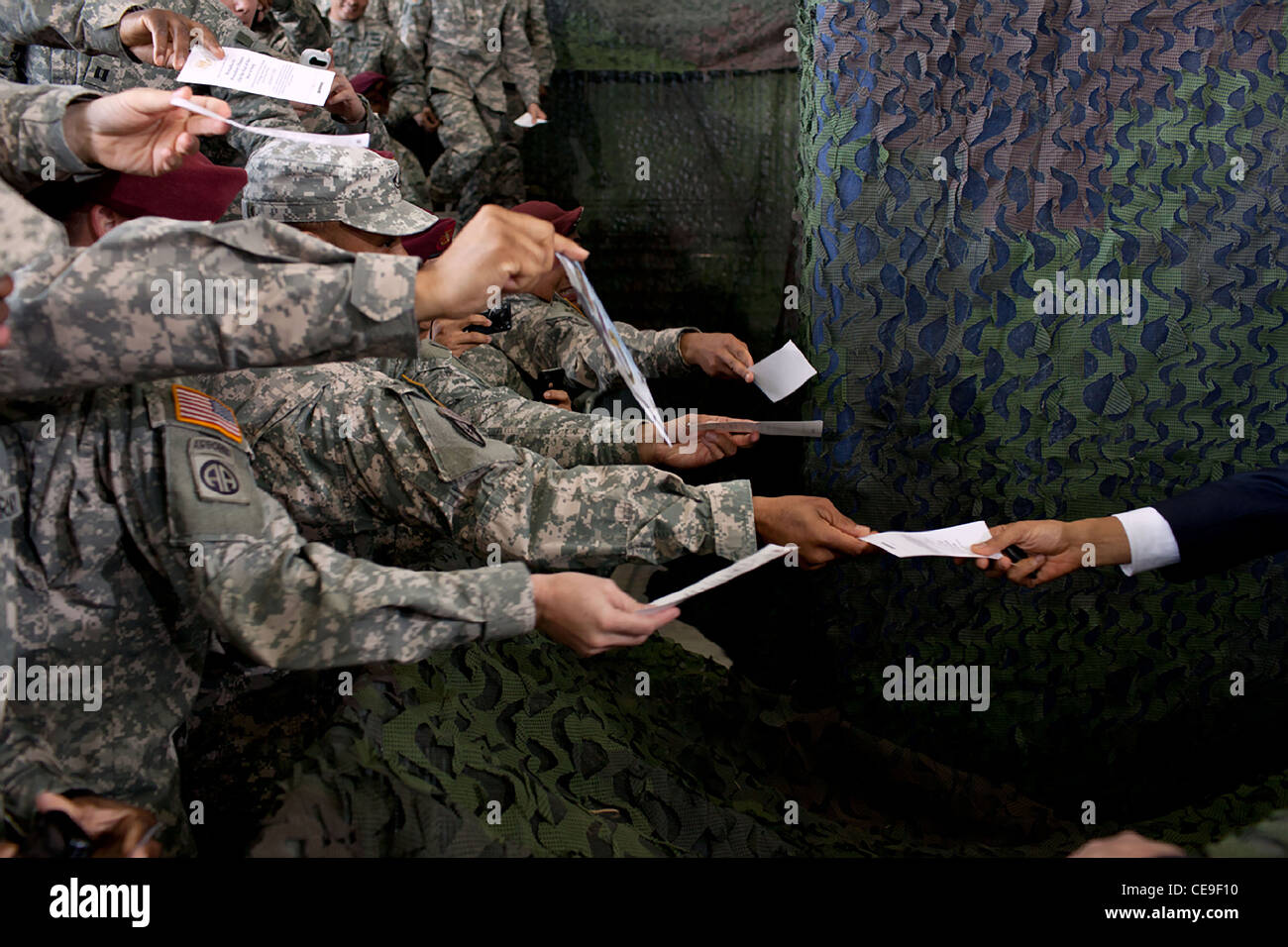 President Barack Obama is handed a piece of paper to autograph following remarks on the end of America's war in - Stock Image