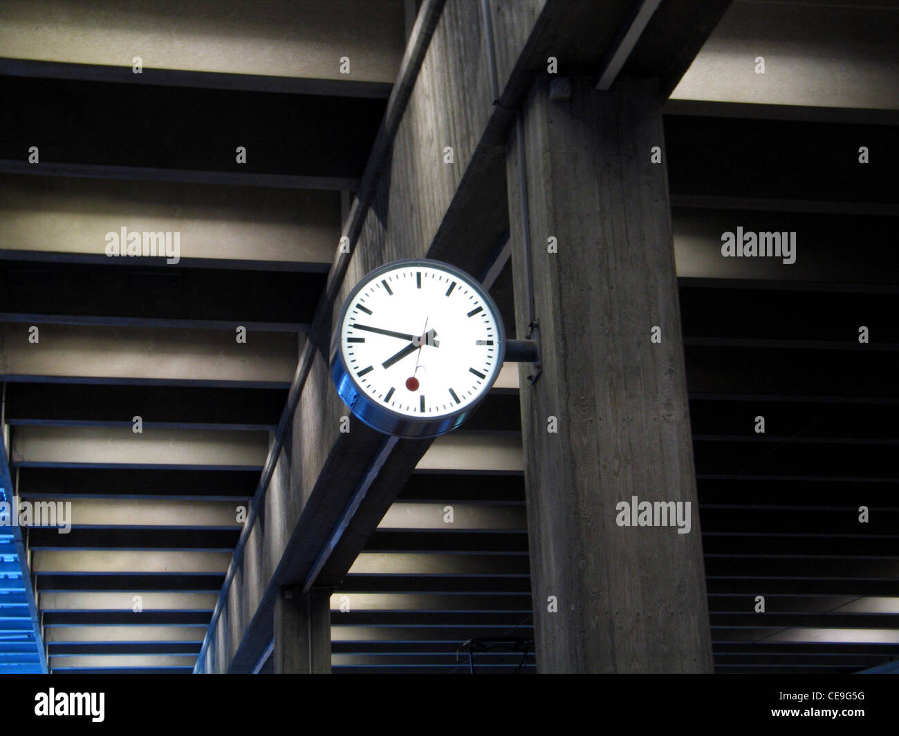 Classic analog clock at a railway station in Switzerland - Stock Image
