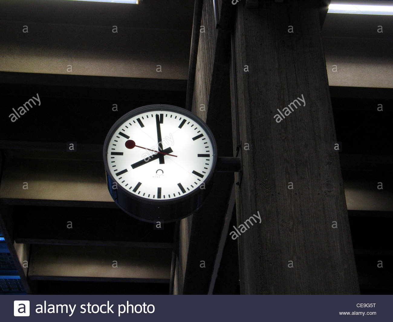 Classic analog clock showing eight o'clock at a railway station in Switzerland - Stock Image