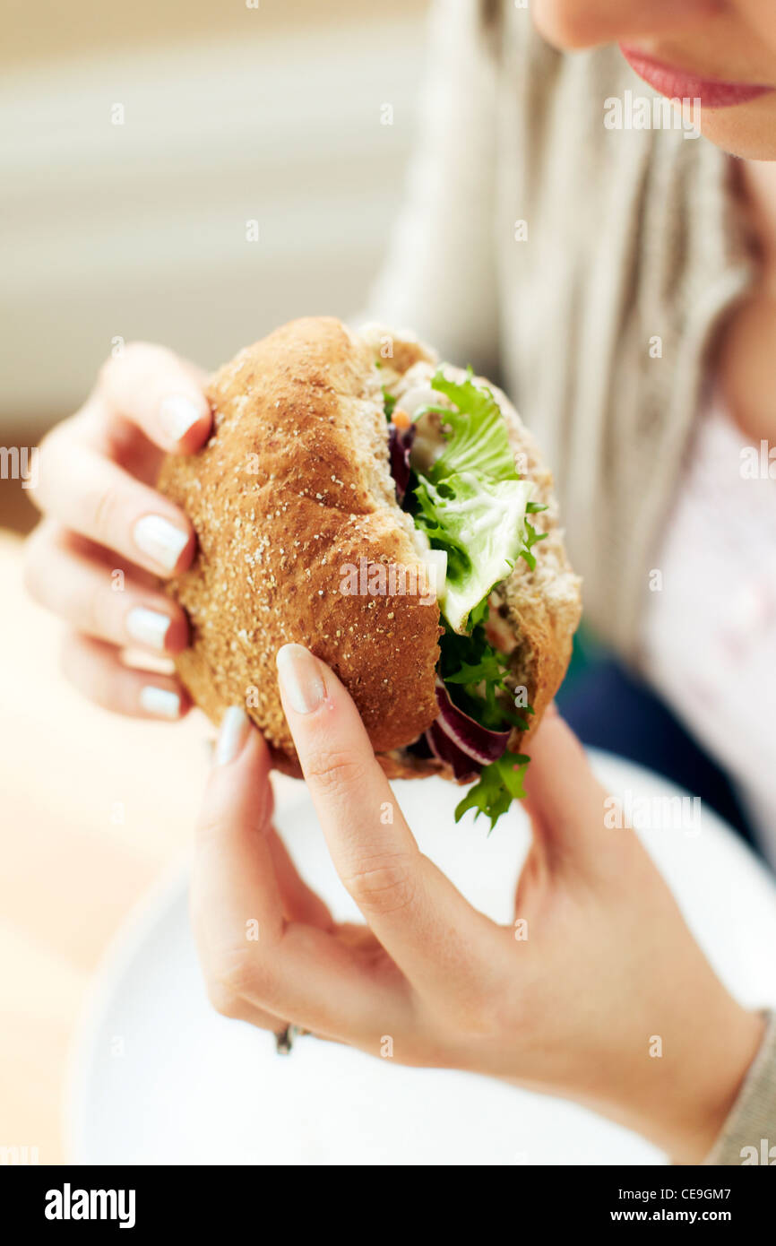 Girl eating healthy sandwich - Stock Image