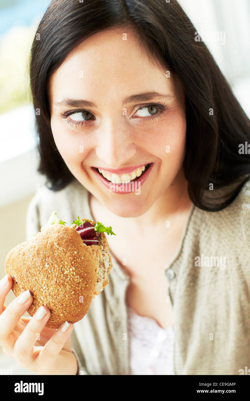 Woman eating healthy sandwich - Stock Image